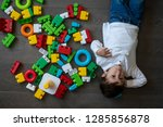 happy baby playing with toy... | Shutterstock . vector #1285856878
