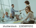 young businesspeople shaking... | Shutterstock . vector #1285899352