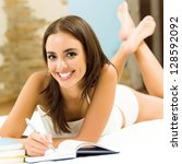 young beautiful woman studying...   Shutterstock . vector #128592092