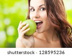 Young Woman Eating Apple ...