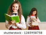 two brunette schoolgirls in... | Shutterstock . vector #1285958758