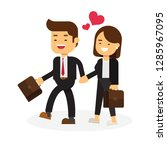 business man and female holding ...   Shutterstock .eps vector #1285967095