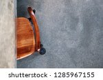 a vintage brown wood chair in... | Shutterstock . vector #1285967155