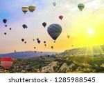 Hot Air balloons flying Tour over Mountains landscape Spring sunset Cappadocia, Turkey nature background