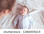 cute baby boy looking at mother ... | Shutterstock . vector #1286005615
