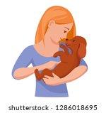 girl holding little puppy...   Shutterstock .eps vector #1286018695