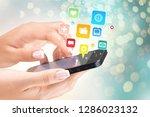 hands holding smartphone  on...   Shutterstock . vector #1286023132