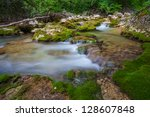 mountain river. a stream of... | Shutterstock . vector #128607848