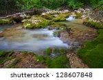mountain river. a stream of... | Shutterstock . vector #128607848