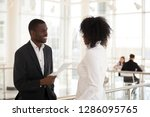 mixed race female talking with...   Shutterstock . vector #1286095765