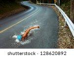 strong man swim on asphalt road   Shutterstock . vector #128620892