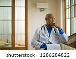 doctor sitting and looking out... | Shutterstock . vector #1286284822
