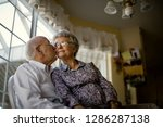 affectionate elderly couple sit ... | Shutterstock . vector #1286287138