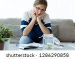 shot of worried young woman... | Shutterstock . vector #1286290858