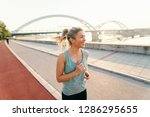 Smiling Female Runner With...