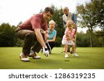 family playing golf together on ... | Shutterstock . vector #1286319235