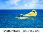 parasailing in aegean sea in... | Shutterstock . vector #1286467528