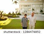 mature man walking with arm... | Shutterstock . vector #1286476852