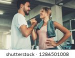 attractive young couple... | Shutterstock . vector #1286501008