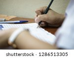 asian students holding pencil... | Shutterstock . vector #1286513305