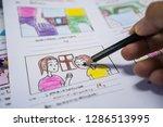 creator drawing story board... | Shutterstock . vector #1286513995