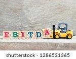 toy forklift hold letter block... | Shutterstock . vector #1286531365