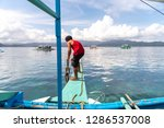 dec 23 2018 a boatman preparing ... | Shutterstock . vector #1286537008