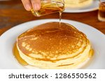 drop syrup on the pancake on... | Shutterstock . vector #1286550562