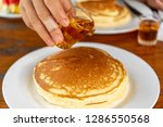 drop syrup on the pancake on... | Shutterstock . vector #1286550568