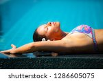 young woman relaxing by the... | Shutterstock . vector #1286605075