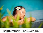 young woman relaxing by the... | Shutterstock . vector #1286605102