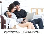 young asian couple using... | Shutterstock . vector #1286619988