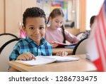 cute african american boy doing ... | Shutterstock . vector #1286733475