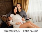 beautiful young pregnant couple ... | Shutterstock . vector #128676032