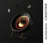 Black Casino Roulette Wheel with Poker Casino Chips on a black background. 3d Rendering  - stock photo