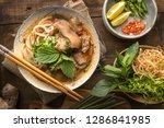 Small photo of Bun Bo Hue, Bun Bo, Vietnamese beef noodle soup spicy. A bowl of beef & rice vermicelli soup, vietnamese noodle cuisine in Hue, Vietnam.