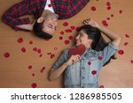 close up of happy couple lying...   Shutterstock . vector #1286985505