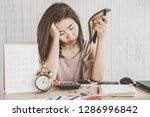 depressed asian woman having... | Shutterstock . vector #1286996842