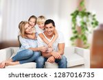 beautiful smiling family in... | Shutterstock . vector #1287016735
