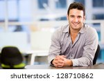 handsome business man smiling... | Shutterstock . vector #128710862