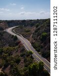curved two lane road going up a ... | Shutterstock . vector #1287111202
