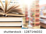 book open in the library | Shutterstock . vector #1287146032