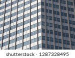windows of office building in... | Shutterstock . vector #1287328495
