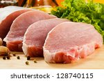 raw pork on cutting board and... | Shutterstock . vector #128740115