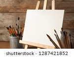 Easel With Blank Canvas Board...