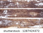 snow covered brown rustic aged... | Shutterstock . vector #1287424372