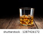 glass of whiskey with ice on... | Shutterstock . vector #1287426172
