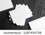 business card blank on wooden... | Shutterstock . vector #1287454738