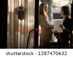 side view of two females... | Shutterstock . vector #1287470632