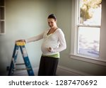 side view of a pregnant woman... | Shutterstock . vector #1287470692